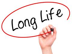 Man Hand writing Long Life with black marker on visual screen Stock Photos