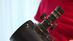 man sets up a telescope, close-up - stock footage