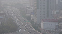 China, busy traffic in Shanghai, cars drive over a major highway through smog - stock footage