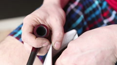 Male scored tobacco smoking pipe closeup Stock Footage