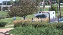 Ambulance drives up to hospital - stock footage