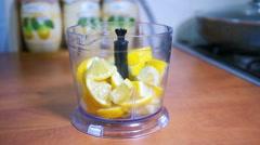Sliced lemon poured into a blender, slow motion Stock Footage