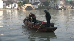 A senior Chinese couple are fishing for clams in small village - stock footage
