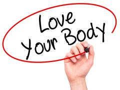 Man Hand writing Love Your Body with black marker on visual screen - stock photo