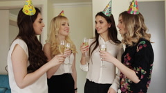young beautiful girls celebrating birthday with glasses of champagne - stock footage