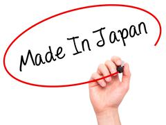 Man Hand writing Made In Japan with black marker on visual screen - stock photo