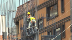 Two Professional Laborers High Up in a New Construction Project - stock footage