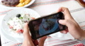 Take a photo of food in a restaurant with mobile phone camera for social network Footage