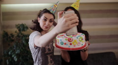 girlfriends selfie with a beautiful cake for the birthday girl - stock footage