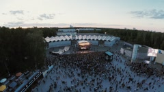 Quadrocopter shoot audience on festival. Evening. Skate park, stage. Landscape - stock footage