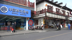 China mobile phone store, restaurants, traditional architecture, contrast Stock Footage