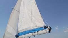 Soaring sail against the sky Stock Footage