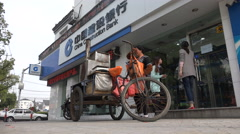 China construction bank, contrast, street vendor, poverty, wealthy - stock footage