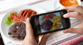 Take a photo picture of food with mobile phone camera view slide gallery Footage