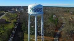Harlem GA Water Tank flyover train below Stock Footage