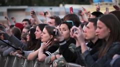 Audience watch on stage, dance, shoot on diferent gadgets. Summer live festival Stock Footage