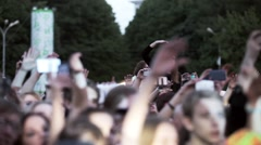 Audience at live fest dance, shoot on phones. Girl on shoulders focus in. Summer Stock Footage
