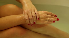 Woman washing her hands keeping on leg Stock Footage