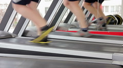 Men running on treadmill, doing toning exercises for leg muscles, healthy life Stock Footage