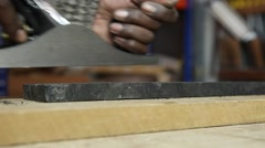 Man using wood planer in workshop Stock Footage