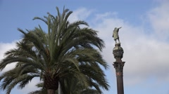 4K Columbus Monument Statue palm tree leaf Barcelona landmark postcard icon day  Stock Footage