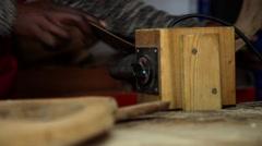 artisan building wood acoustic guitar , slider shot - stock footage