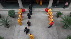 Traditional religious ceremony inside a modern Chinese temple in Shanghai - stock footage