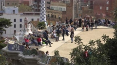 4K Tourist people relax serpentine seating main terrace park Guell Barcelona day Stock Footage