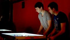 Young guys having fun playing table football. Stock Footage