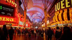 Tourist Cross The Road at Fremont Street at Night in Las Vegas Stock Photos
