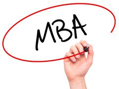 Man Hand writing MBA with black marker on visual screen - stock photo