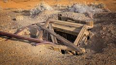 Abandoned Mine Shaft in Western Gold Rush Town - stock photo