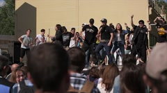 Dancing people on stage. Men show dance movements. Summer fest. Slow motion Stock Footage