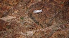 Sea Level Sign on Mountain Side in Death Valley - stock photo