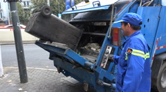 City workers collect trash in the streets of Shanghai, China - stock footage