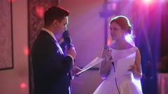 The groom wedding speech to the bride and kisses her Stock Footage