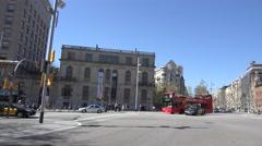 4K Pan left follow touristic double decker bus Barcelona avenue traffic car rush Stock Footage