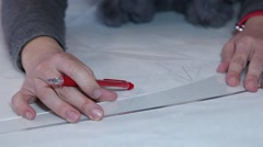 woman uses ruler for making strokes with pencil,slider shot - stock footage