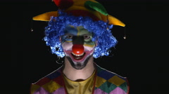 Young hilarious evil clown making scary faces Stock Footage