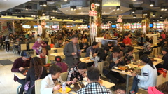 People eat lunch in busy popular restaurant in Shanghai China Stock Footage