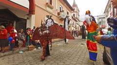 Masked Men on Stilts Pose for the Camera in San Antonio, Ecuador Stock Footage