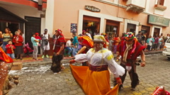 Parade Dancers with Traditional Dress Dance Down the Street Stock Footage