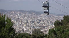 4K Famous Montjuic Cable Car gondola lift down Barcelona cityscape skyline day   Stock Footage
