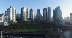 Aerial flying towards yaletown park and condos Stock Footage