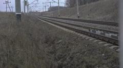 Railway track, isolators, grey grass in the Ukrainian fields. 4K - stock footage