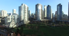 Stock Video Footage of fast aerial flight towards yaletown park and condos