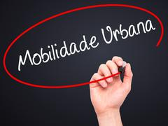 Man Hand writing Mobilidade Urbana (Urban Mobility in Portuguese with black m - stock photo
