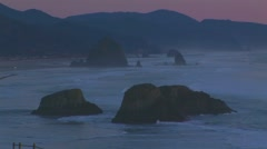 Low tide with pink sky and mountains - stock footage