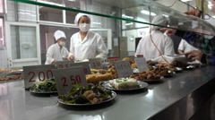 Chefs prepare lunch for students at campus of the Shanghai University in China - stock footage
