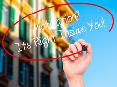 Man Hand writing Motivation? Its Right Inside You!  with black marker on visu - stock photo